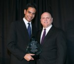 Frank accepts the Noel N. Kriftcher Service to Education Award on behalf of New York Life