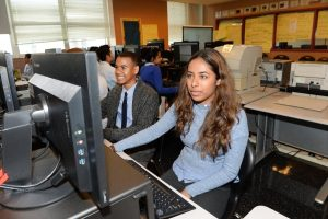 Students Brandon Prenz (l.) and Entasa Chowdhury (r.) in class at the Academy of Finance and Enterprise. (DEBBIE EGAN-CHIN/NEW YORK DAILY NEWS)